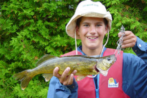 A successful day of fishing at Lake Edge Cottages for this boy, holding his fish